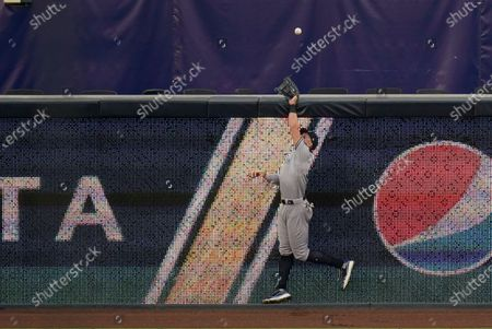 New York Yankees' Aaron Judge cannot make a catch on a home run hit by Tampa Bay Rays' Austin Meadows during the fifth inning in Game 5 of a baseball American League Division Series, in San Diego