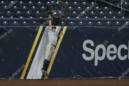 New York Yankees' Brett Gardner (11) makes the catch on a ball hit by Tampa Bay Rays' Randy Arozarena during the sixth inning in Game 5 of a baseball AL Division Series, in San Diego