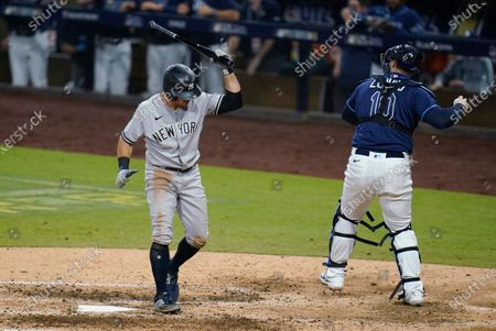 New York Yankees' Brett Gardner reacts after striking out during the seventh inning in Game 5 of the baseball team's AL Division Series against the Tampa Bay Rays, in San Diego