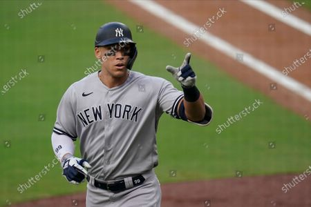 New York Yankees' Aaron Judge reacts after hitting a solo home run during the fourth inning in Game 5 of a baseball American League Division Series against the Tampa Bay Rays, in San Diego
