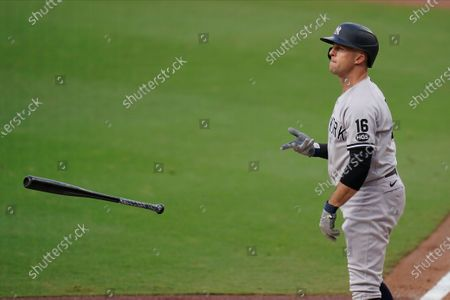 New York Yankees' Brett Gardner (11) tosses his bat after walking during the third inning in Game 5 of a baseball American League Division Series against the Tampa Bay Rays, in San Diego