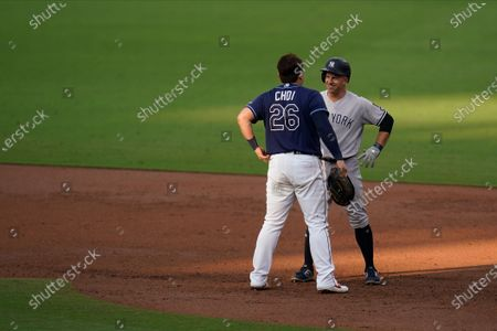 Stock Image of Tampa Bay Rays' Ji-Man Choi (26) talks with New York Yankees' Brett Gardner (11) during a pitching change in third inning in Game 5 of a baseball American League Division Series, in San Diego