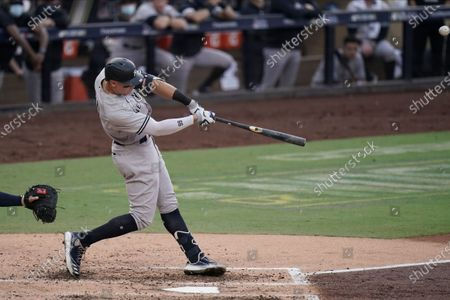 New York Yankees' Aaron Judge hits a solo home run during the fourth inning in Game 5 of a baseball American League Division Series against the Tampa Bay Rays, in San Diego