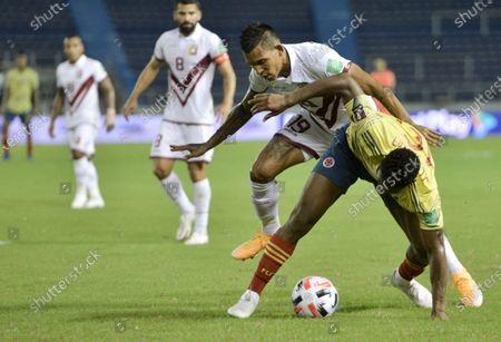 Venezuela's Andres Ponce, left, and Colombia's Jefferson Lerma battle for the ball during a qualifying soccer match for the FIFA World Cup Qatar 2022 in Barranquilla, Colombia