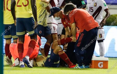 Colombia's Santiago Arias lies on the grass injured during a qualifying soccer match against Venezuela for the FIFA World Cup Qatar 2022 in Barranquilla, Colombia