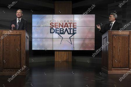 Republican U.S. Sen. Cory Gardner, right, and Democratic former Colorado Gov. John Hickenlooper participate in a debate, in Denver