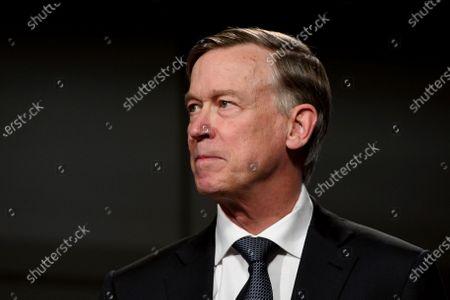 Democratic former Colorado Gov. John Hickenlooper listens during a debate with Republican U.S. Sen. Cory Gardner, in Denver