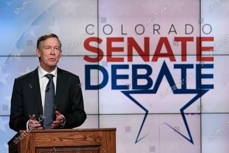 Democratic former Colorado Gov. John Hickenlooper speaks during a debate with Republican U.S. Sen. Cory Gardner, in Denver