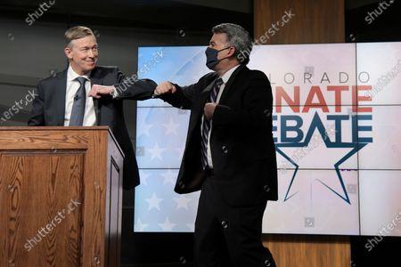 Republican U.S. Sen. Cory Gardner, right, and Democratic former Colorado Gov. John Hickenlooper elbow bump after a debate, in Denver