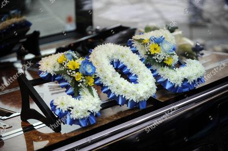 Filming the funeral of Joe McIntyre. Joe's wreath.
