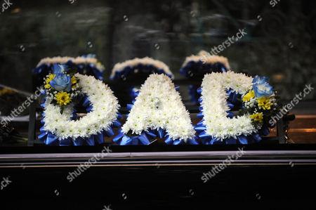 Filming the funeral of Joe McIntyre. Dad wreath.