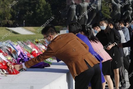 People visit the Mansu Hill to lay flowers to the bronze statues of former North Korean leaders Kim Il Sung and Kim Jong Il in Pyongyang, North Korea, on the occasion of the 75th founding anniversary of the country's Workers' Party