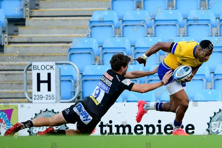 Jack Maunder of Exeter Chiefs challenges Anthony Watson of Bath Rugby