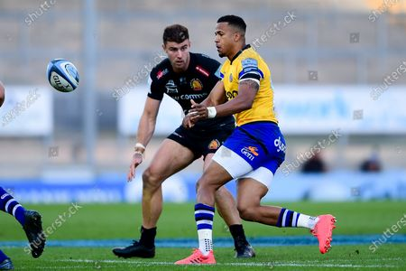 Ollie Devoto of Exeter Chiefs challenges Anthony Watson of Bath Rugby