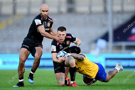 Stock Picture of Rhys Priestland of Bath Rugby is tackled by Josh Matavesi of Bath Rugby
