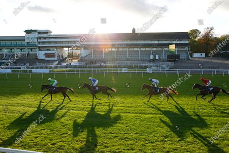 Stock Picture of The sun goes down at Chepstow as Auda Me Yang leads winner Knappers Hill and Harry Cobden to victory.