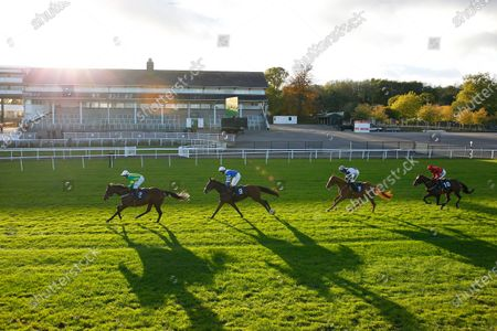 Stock Photo of The sun goes down at Chepstow as Auda Me Yang leads winner Knappers Hill and Harry Cobden to victory.