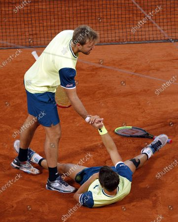 Kevin Krawietz (L) and Andreas Mies of Germany react after winning against Mate Pavic of Croatia and Bruno Soares of Brazil in the men's doubles final match during the French Open tennis tournament at Roland Garros in Paris, France, 10 October 2020.