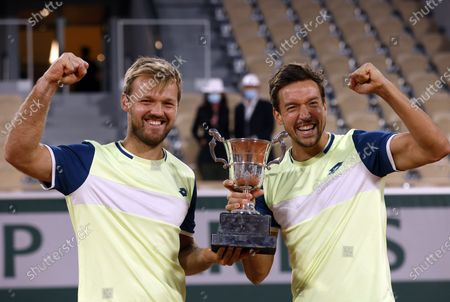 Kevin Krawietz (L) and Andreas Mies of Germany celebrate with the trophy after winning against Mate Pavic of Croatia and Bruno Soares of Brazil in the men's doubles final match during the French Open tennis tournament at Roland Garros in Paris, France, 10 October 2020.