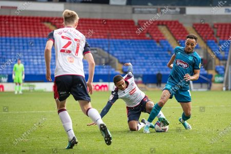 Stock Photo of Bolton Wanderers midfielder Brandon Comley (8) challenges the opponent during the EFL Sky Bet League 2 match between Bolton Wanderers and Grimsby Town FC at the University of  Bolton Stadium, Bolton