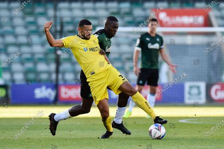 Colin Daniel  (3) of Burton Albion battles for possession with Frank Nouble (7) of Plymouth Argyle during the EFL Sky Bet League 1 match between Plymouth Argyle and Burton Albion at Home Park, Plymouth