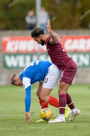 Jordan Roberts (#11) of Heart of Midlothian FC closely marks Michael Herd (#10) of Cowdenbeath FC during the Betfred Scottish League Cup match between Cowdenbeath FC and Heart of Midlothian FC at Bayview Stadium, Methil