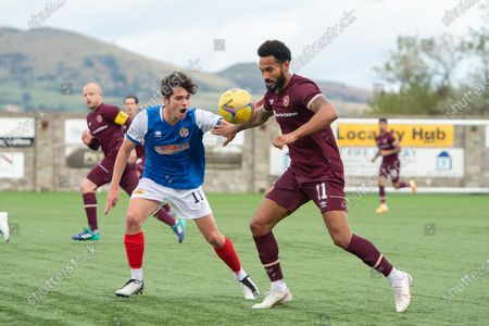 Jordan Roberts (#11) of Heart of Midlothian FC holds off Oliver Hamilton (#11) of Cowdenbeath FC during the Betfred Scottish League Cup match between Cowdenbeath FC and Heart of Midlothian FC at Bayview Stadium, Methil