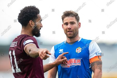 Jordan Roberts (#11) of Heart of Midlothian FC speaks with Craig Barr (#5) of Cowdenbeath FC after the award of a penalty to Hearts during the Betfred Scottish League Cup match between Cowdenbeath FC and Heart of Midlothian FC at Bayview Stadium, Methil