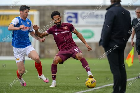Jordan Roberts (#11) of Heart of Midlothian FC shields the ball from Cian Kavanagh (#8) of Cowdenbeath FC during the Betfred Scottish League Cup match between Cowdenbeath FC and Heart of Midlothian FC at Bayview Stadium, Methil