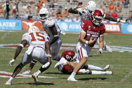 Oklahoma quarterback Tanner Mordecai (15) tries to get past Texas defensive back Chris Brown (15) during an NCAA college football game in Dallas