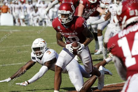 Stock Picture of Oklahoma wide receiver Theo Wease (10) catches a two-point conversion as Texas defensive back Jalen Green (3) defends during the second half of an NCAA college football game in Dallas,Tx, . Oklahoma defeated Texas 53-45 in four overtimes