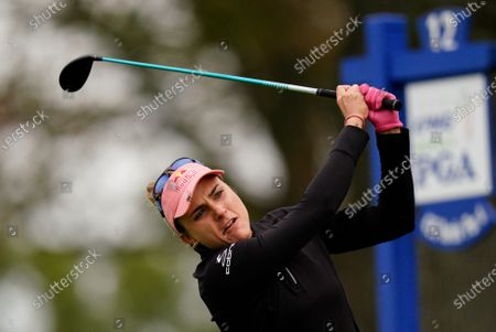 Stock Image of Lexi Thompson watches her tee shot on the 12th hole during the third round at the KPMG Women's PGA Championship golf tournament at the Aronimink Golf Club, in Newtown Square, Pa