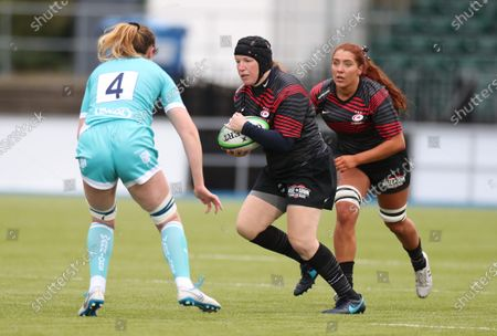 Stock Image of Rocky Clark of Saracens takes on Amelia Buckland Hurry of Worcester