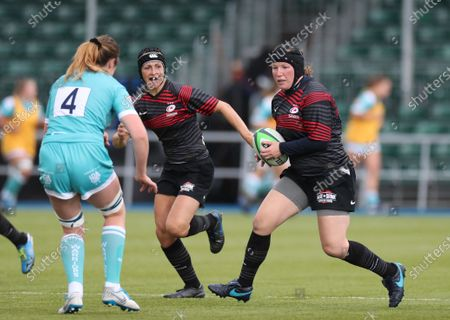 Rocky Clark of Saracens takes on Amelia Buckland Hurry of Worcester