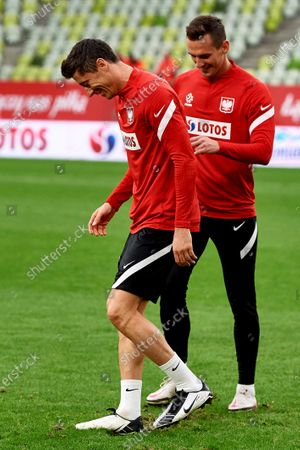 Stock Image of Polish national soccer team forwards Robert Lewandowski (L) and Arkadiusz Milik (R) in action during a training session in Gdansk, Poland, 10 October 2020. Poland will face Italy in their UEFA Nations League group stage, league A, group 1 soccer match in Gdansk, Poland on 11 October 2020.