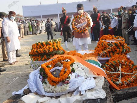 Union Law Minister Ravi Shankar Prasad pays tribute to the mortal remains of Union minister and Lok Janshakti Party (LJP) leader Ram Vilas Paswan before his cremation, at Janardan Ghat, on October 10, 2020 in Patna, India. A large crowd, including several political leaders, gathered outside the residence of Paswan to pay last respect to the departed leader. The mortal remains of LJP's founder were flown from Delhi to Patna on Friday for the last rites. Paswan became an iconic leader in Indian politics as he won from Hajipur Lok Sabha constituency eight times between 1977 and 2014. In 1977 and 1980, Paswan had won on a Janata Party ticket. In 1977, he registered a Guinness World Record by winning the election from Hajipur with a margin of 4.24 lakh votes, the maximum margin by any politician in the world.