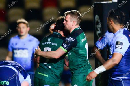 Stock Photo of Cardiff Blues vs Connacht. Connacht's John Oliver celebrates scoring a try with Jack Carty
