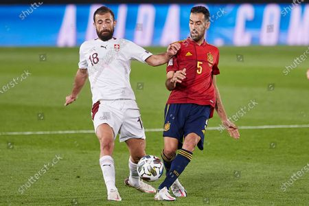 Sergio Busquets of Spain and Admir Mehmedi of Switzerland