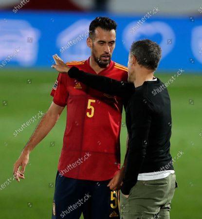 Spain's Sergio Busquets, left speaks toSpain coach Luis Enrique during the UEFA Nations League soccer match between Spain and Switzerland in Madrid, Spain