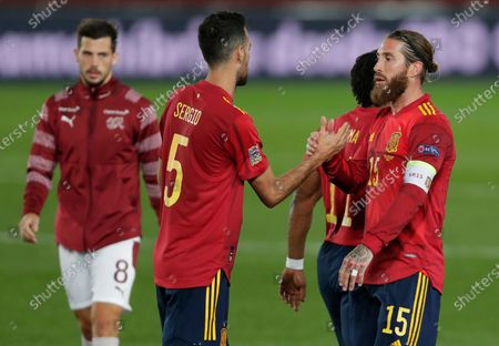 Spain's Sergio Busquets, left shakes hands with Spain's Sergio Ramos after the end of the UEFA Nations League soccer match between Spain and Switzerland in Madrid, Spain, .Spain won the game 1-0