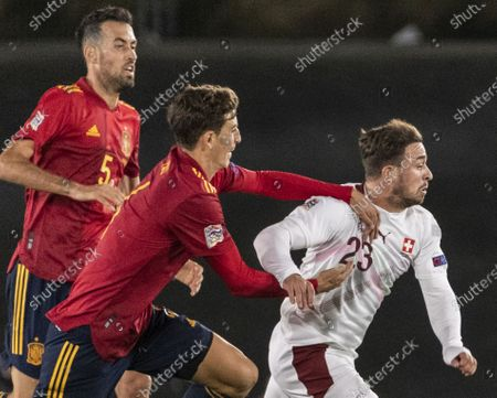 Switzerland's Xherdan Shaqiri (R) vies with Spain's Sergio Busquets (L) and Pau Torres during the UEFA Nations League soccer match between Spain and Switzerland, at the Alfredo Di Stefano stadium in Madrid, Spain, 10 October 2020.