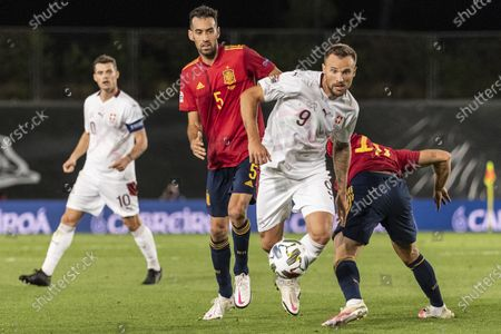 Switzerland's Haris Seferovic (R) fights for the ball against Spain's Sergio Busquets during the UEFA Nations League soccer match between Spain and Switzerland, at the Alfredo Di Stefano stadium in Madrid, Spain, 10 October 2020.