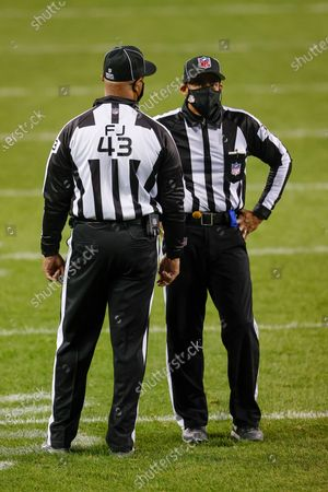 Field Judge Terry Brown, left, talks with Line Judge Greg Bradley, right, during the second half of an NFL football game between the Chicago Bears and Tampa Bay Buccaneers, in Chicago