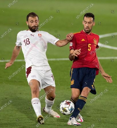 Spain's Sergio Busquets (R) in action against Switzerland's Admir Mehmedi (L) during the UEFA Nations League group stage, group 4 soccer match, between Spain and Switzerland at Alfredo di Stefano stadium in Madrid, Spain, 10 October 2020.