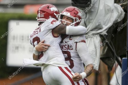 Arkansas quarterback Feleipe Franks (13) celebrates with wide receiver Mike Woods (8) after a touchdown against Auburn during the second quarter of an NCAA college football game, in Auburn, Alabama