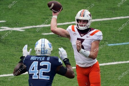 Virginia Tech quarterback Braxton Burmeister (3) passes against North Carolina linebacker Tyrone Hopper (42) during the first half of an NCAA college football game in Chapel Hill, N.C