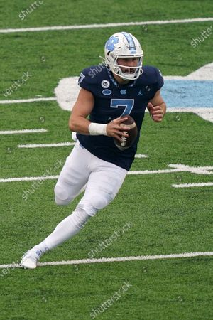 North Carolina quarterback Sam Howell (7) scrambles against Virginia Tech during the first half of an NCAA college football game in Chapel Hill, N.C