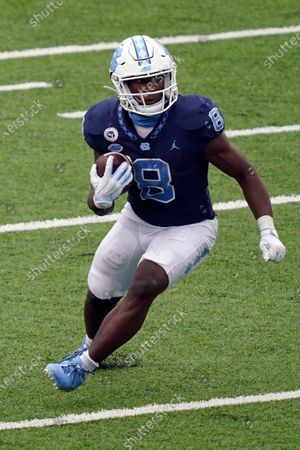 North Carolina running back Michael Carter (8) runs against Virginia Tech during the second half of an NCAA college football game in Chapel Hill, N.C