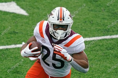 Virginia Tech running back Khalil Herbert (25) runs the ball against North Carolina during the first half of an NCAA college football game in Chapel Hill, N.C