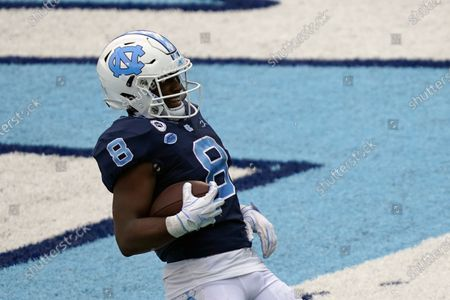 North Carolina running back Michael Carter (8) scores a touchdown against Virginia Tech during the second half of an NCAA college football game in Chapel Hill, N.C